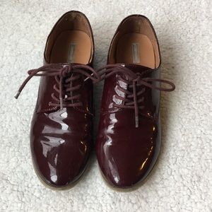 Shiny maroon lace up shoes